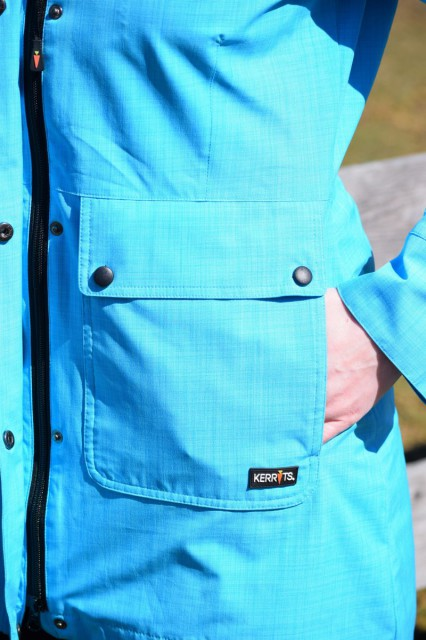 The jacket also features two (very) generously sized pockets in the front that snap open/closed - and they have diagonal cut opening to a separate compartment on the sides for your hands as well - Photo by Lorraine Peachey