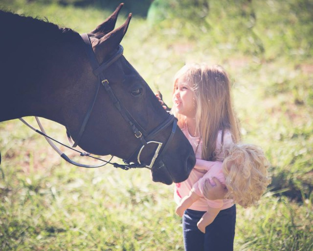 Spirit bonds with a young friend. Photo by Kate Wilson Photography