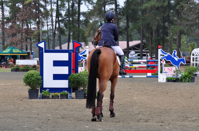 Nyls Du Terroir and Kate Samuels pose beside the EN jump built by Brody Robertson, which made an appearance in the ring as both an obstacle and decor. Photo by Leslie Threlkeld
