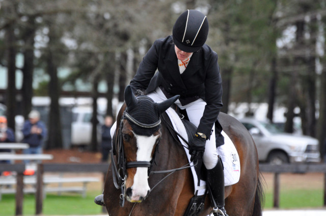 Sharon White praises Wundermaske after a dressage test that scored 30.7. They finished second in Advanced-A and are on the road to Rolex. Photo by Leslie Threlkeld