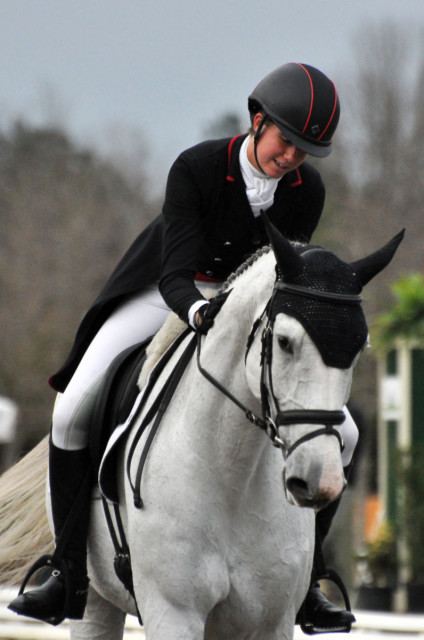 Caroline Martin pats her Holsteiner Center Stage after an elegant test in the two-star. Photo by Leslie Threlkeld