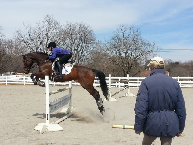Meghan Perry in her jump lesson with Eric