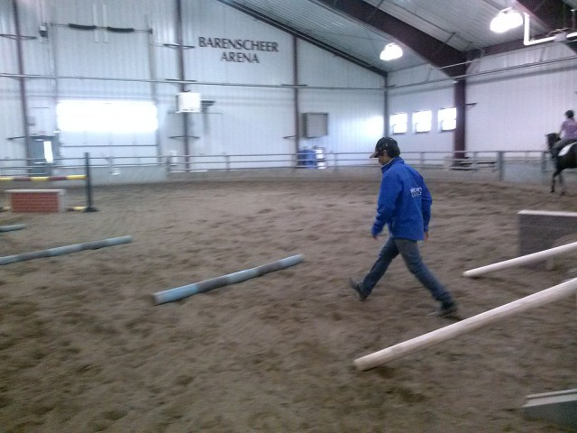 Dom walks out the distance for placement poles to help a rushing horse slow the canter.