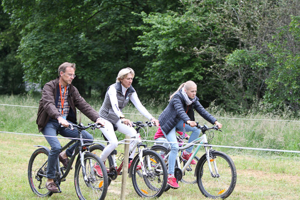 The Klimke family bikes the cross country course. Photo by Lutz Kaiser/buschreiter.de.