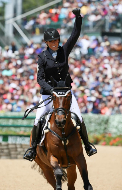 One K rider Laine Asker celebrates her stadium round with Anthony Patch. Photo by Rare Air Photography.