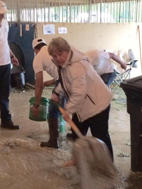 USEA President Diane Pitts helps to drain the barns. Photo by Tamie Smith.