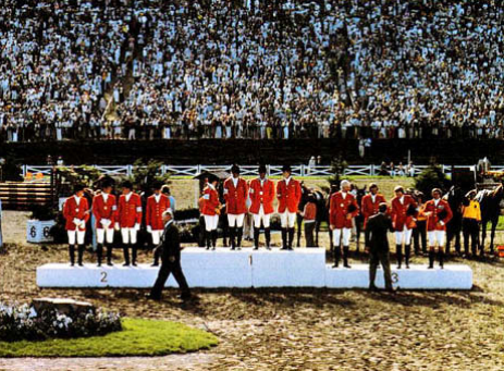 Team USA taking Team Gold in 1976. The team included Edmund Coffin/Bally Cor, John Plumb/Better & Better, Bruce Davidson/Irish Cap and Mary Tauskey /Marcus Aurelius. Credit: