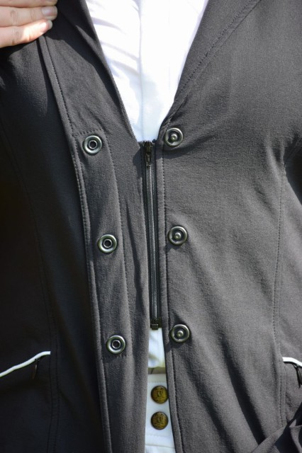 the zipper holds the front of the jacket nicely together, so that there is not tension on the buttons of the Competitor Koat - Photo by Lorraine Peachey