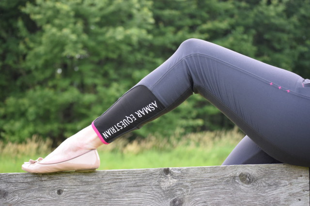 The Heritage Breeches also feature a smooth stocking at the bottom, is finished off with a classic bottom hem…which also happens to be the same fun accent shade of pink. To add an extra little pop of style, the smooth stocking of the left leg also includes a printed 'Asmar Equestrian' logo in white - Photo by Lorraine Peachey