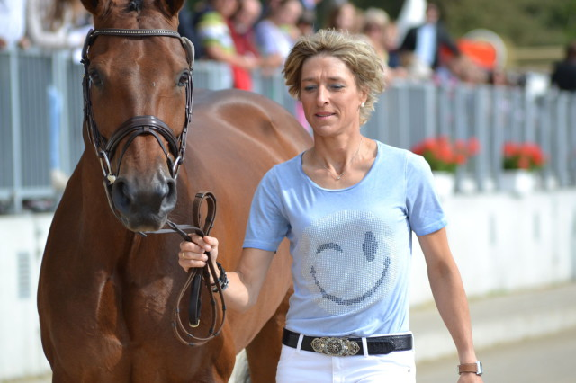 Overnight leader Ingrid Klimke and FRH Escada JS (GER) kick Sunday off with a wink and a smile. Photo by Leslie Wylie.