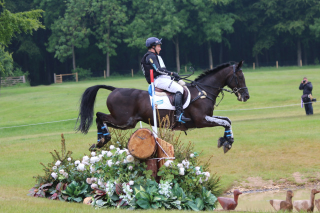 Ben Hobday and Baroque Du Vi leap into the first water on the Equi-Trek Bramham CCI3* cross country — yehboi! Photo by Samantha Clark.