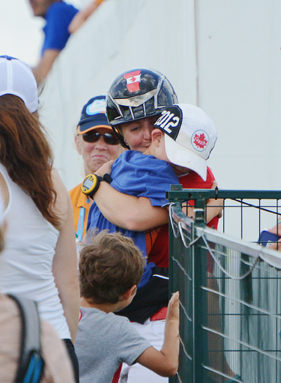 Jessica Phoenix hugs her son Jacob after her clear cross country trip. Photo by Jenni Autry.