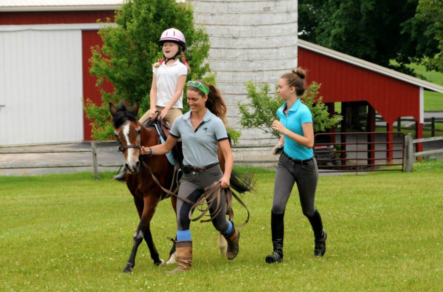 Upper level members teach younger members the basics of riding and horse care. Photo by Gillian Warner.