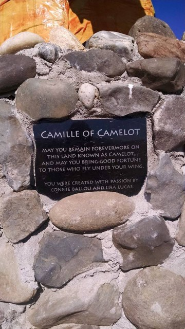 Plaque on the Dragon Camille, a stone dragon that glows in the dark at night! Photo by Louis Blankenship.
