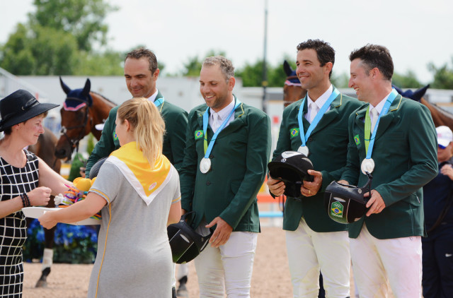 Ruy Fonseca, Carlos Paro, Marcio Carvalho Jorge and Henrique Plambon accept their team silver medals. Photo by Jenni Autry.