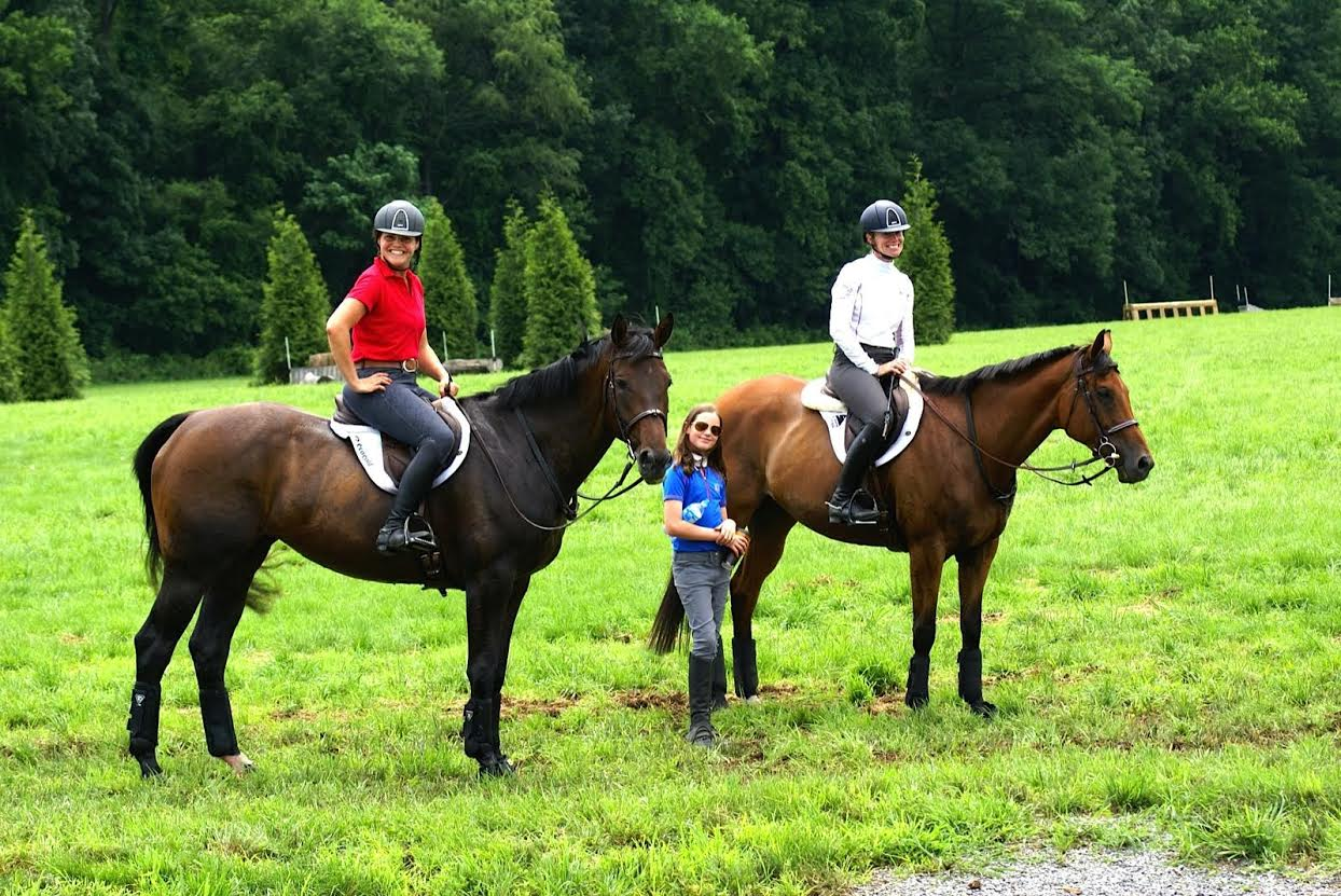 "Meg and ""Tegan"", Sinead on Gail Opatuts' High Altitude and Kasey Callanan on the ground while cross country schooling at Windurra. Photo courtesy of Brian Callanan."