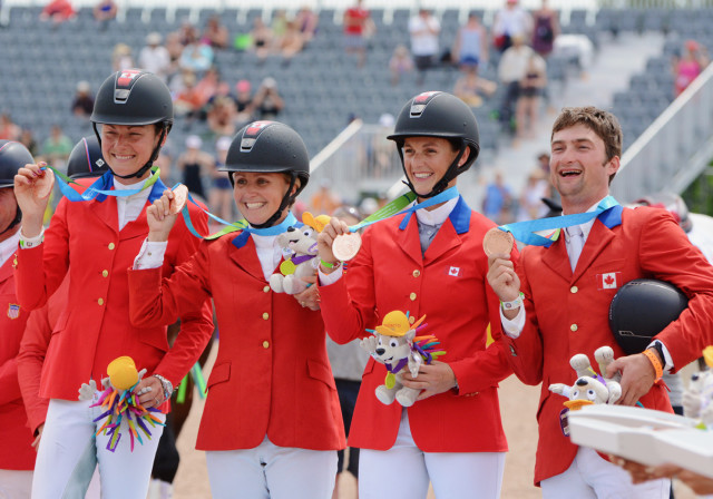 Kathryn Robinson, Jessica Phoenix, Colleen Loach and Waylon Roberts show off their team bronze medals. Photo by Jenni Autry.