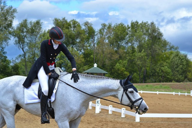 Caroline Martin gives Center Stage a well deserved pat after dressage. Photo by Leslie Wylie.