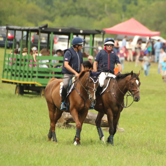 Boyd Martin and Phillip Dutton lead the spectators out to the cross country course. Photo by Cindy Lawler.