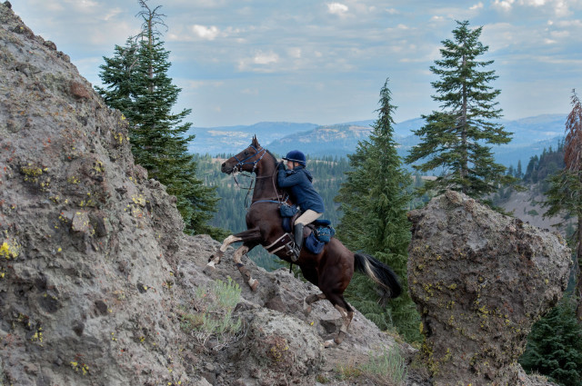 Hilda Donahue and Tuff Stuff climb Cougar Rock at Tevis. Photo by Gore/Baylor Photography