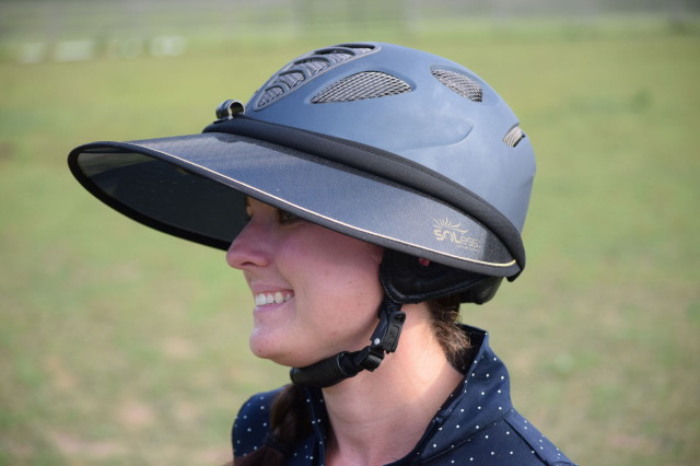The Soless Gold has a strap that tightens nicely around the helmet, and then a visor clip is added to the front for additional security while riding. Photo by Lorraine Peachey.