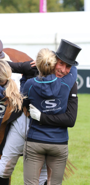 Tim Price being congratulated by wife Jonelle and the whole of the NZ squad after a super test on Ringwood Sky Boy for 38.7 and 3rd currently