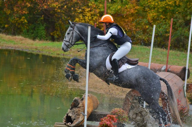 Alyssa Peterson & Sharon White's Ready Or Not kept their second place with a double clear. Photo by Charles Larkin.