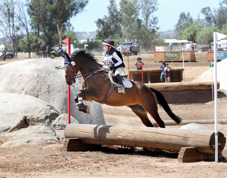 Elise and Cookie out on course. Photo courtesy of Captured Moment Photography.