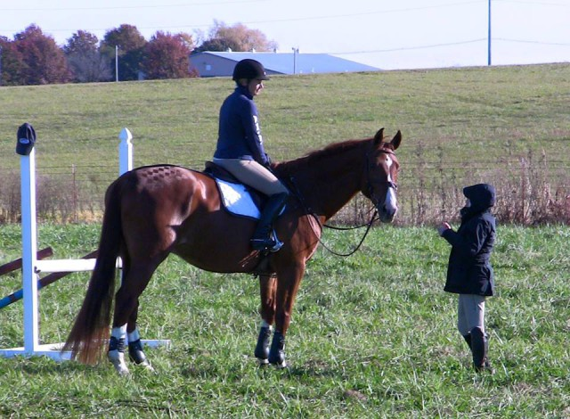 Hawley gives Prelim pair Amanda Pezold and Beth McDaniel's Alabar some pointers. Photo by Beth McDaniel.