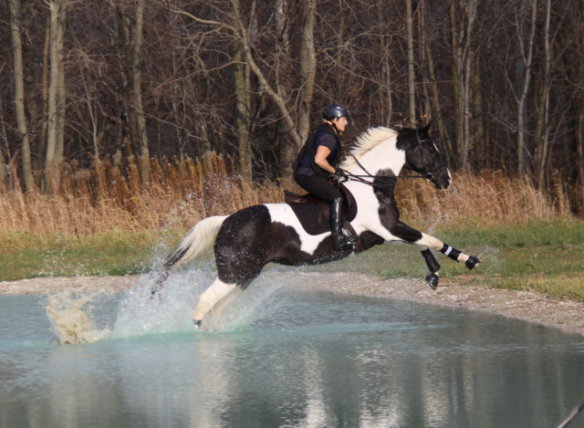 Sue Cornwall rides through the water complex. Photo by Denya Massey.