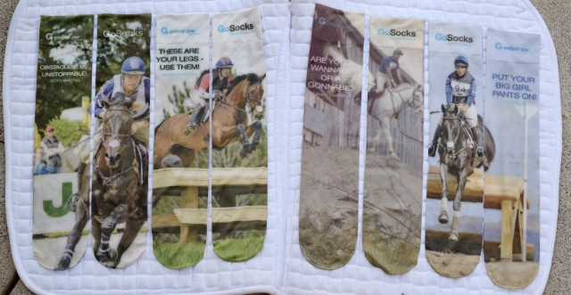 GoSocks come in four different designs, including (from left to right) Boyd Martin, Buck Davidson, Denny Emerson, and Gina Miles. Photo by Jim Holbel.
