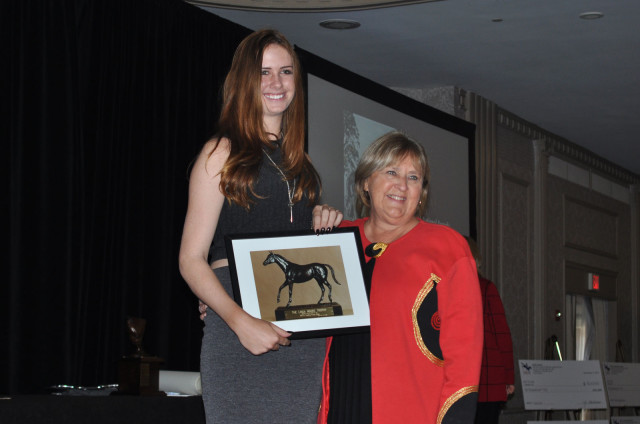 Eventing 25 rider Caroline Martin accepting an award from USEA President Diane Pitts at the 2015 USEA Year-End Awards. Photo by Leslie Threlkeld