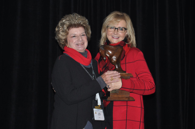 Kyra Stuart and Heidi Vahue received the Andrew H. Popiel Memorial Trophy, which acknowledges an event organizer's commitment to the sport. Kyra (pictured) and Heidi organized the Stuart Horse Trials for 26 years and announced this year that 2015 would be the event's last year. Photo by Leslie Threlkeld.