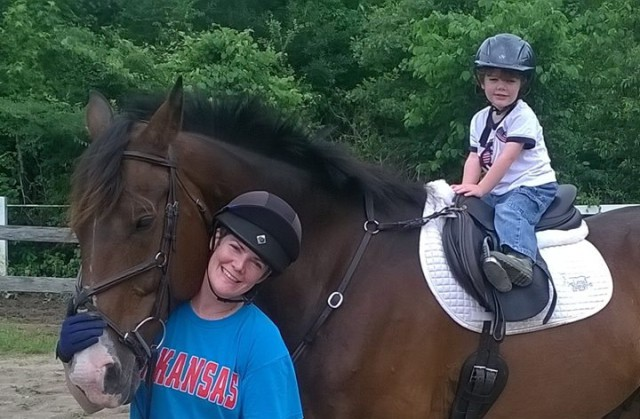 My son Nate and I and my TB/Shire gelding Syd. Photo credit: my husband Tim Wadley.