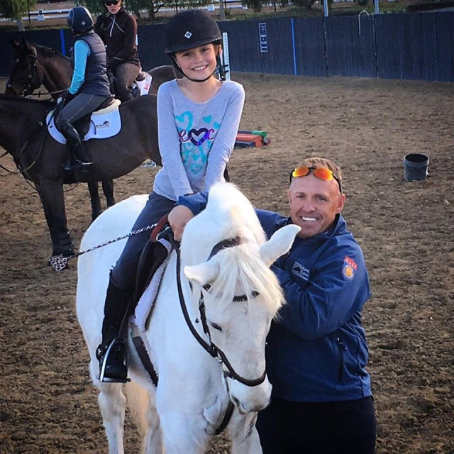 Buck Davidson has been out in California teaching lessons. Here he is with Taylor McFall. Photo courtesy of Dragonfire Farm.