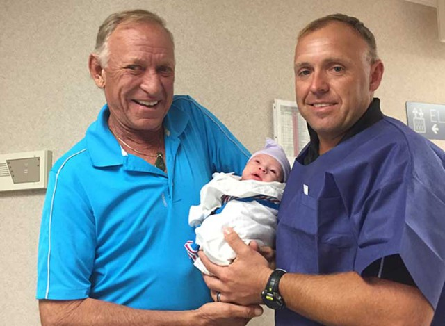 Bruce and Buck Davidson with baby Aubrey. Photo courtesy of Buck Davidson.