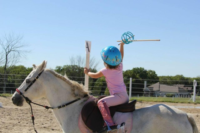 Claire practicing mounted games at age 4. Photo courtesy of Anne Peters.