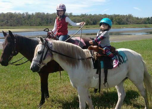 Claire trail-riding at 18 months old. Photo courtesy of Anne Peters.