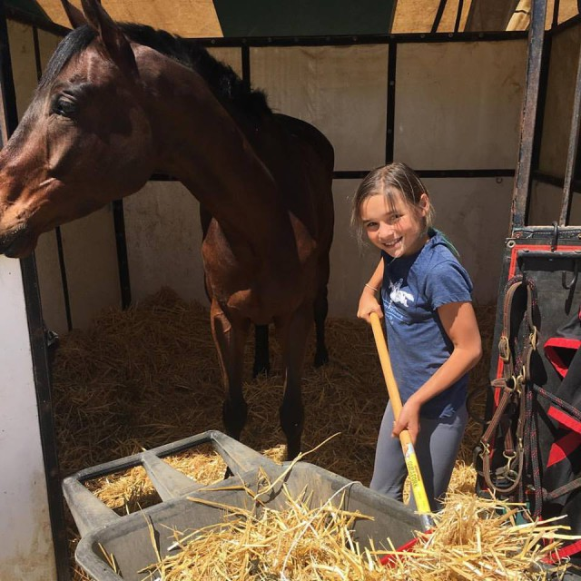 Gettin' it done! Taylor McFall is cleaning stalls at Twin Rivers to help raise money to fund her show season. Photo from Earl and Jen McFall's Facebook page