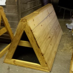 Solid coop and a narrow-slatted coop built for both in and out of the arena