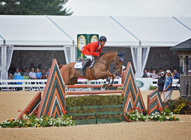 Heavy rains fell on and off while the top 20 were show jumping. Boyd Martin and Blackfoot Mystery persevered to have one rail down. Photo by Jenni Autry.