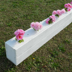 Push stems down into the holes and drill more holes to create a fuller look to your flower box filler
