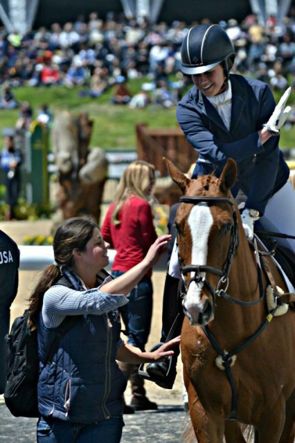 Savannah Kilpatrick congratulates Lillian and Share Option after show jumping at Rolex Kentucky. Photo by JJ Silliman.