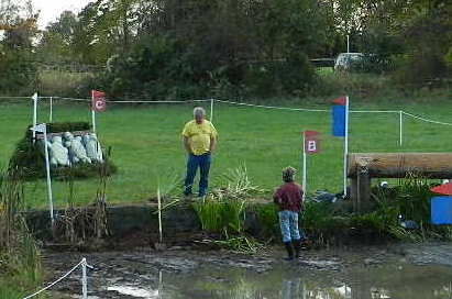 The late Judy Thayer, Cross-country director at Fair Hill, agonizing over a water jump design at Fair Hill International (2012) Photo by Holly.