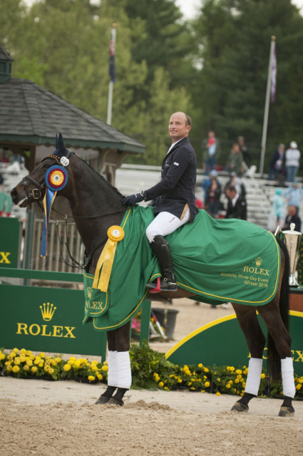 Michael Jung and fischerRocana FST listen to Germany's national anthem in the Rolex Arena.