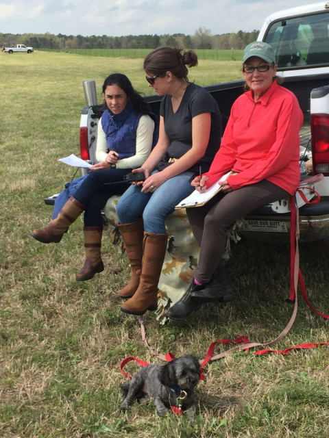 Susan Garbow (far right) volunteering at Pine Top Farm this spring with her dog, Teddy, Layton Moss (left) and Keeley Beckman (middle). Photo by Janet Wilson.