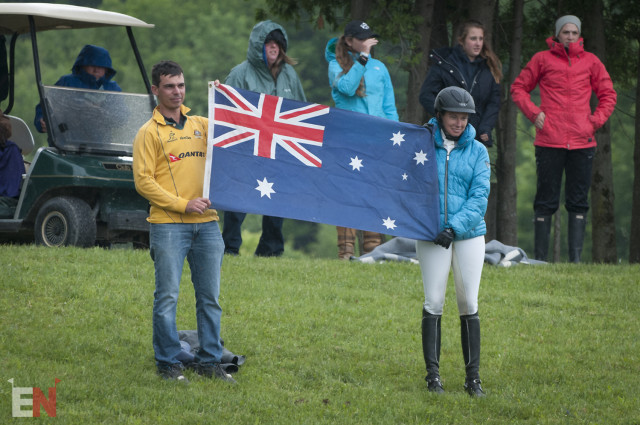 Dom Schramm and Kate Chadderton hold up the Australian flag during awards. Photo by Leslie Threlkeld.