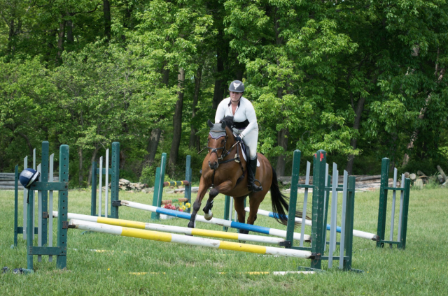 Sarah Tompkins and Braeden demonstrate the warmup exercise on show jumping day. Photo by Eliza Goldberg.