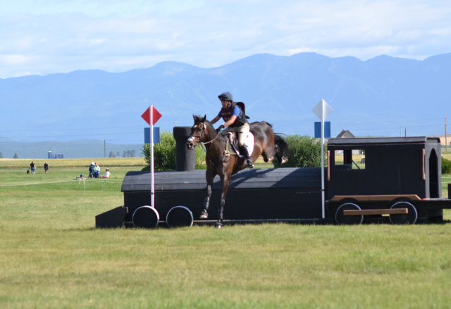 Barb Crabo and Eveready were full of running over the last fence in the Rebecca Farm CIC3*. Photo by Leslie Wylie.