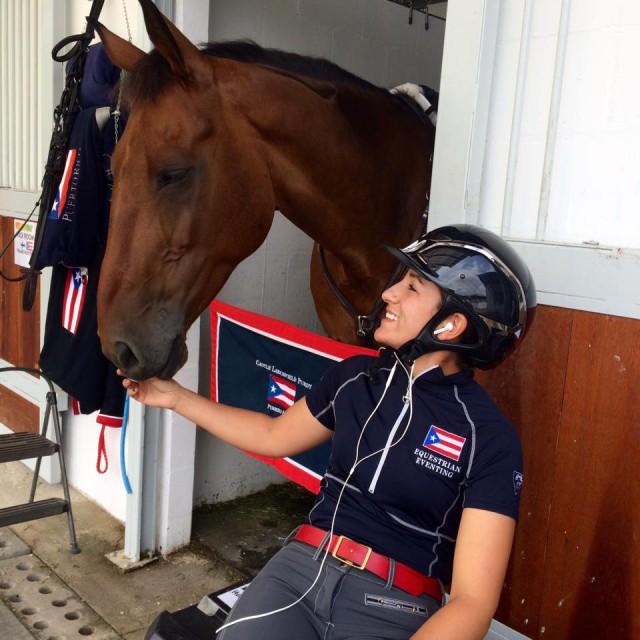 Lauren Billys and Castle Larchfield Purdy share a moment in Rio. Photo via Bea di Grazia.